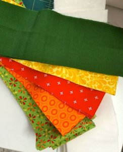Sue just loves green and orange!
